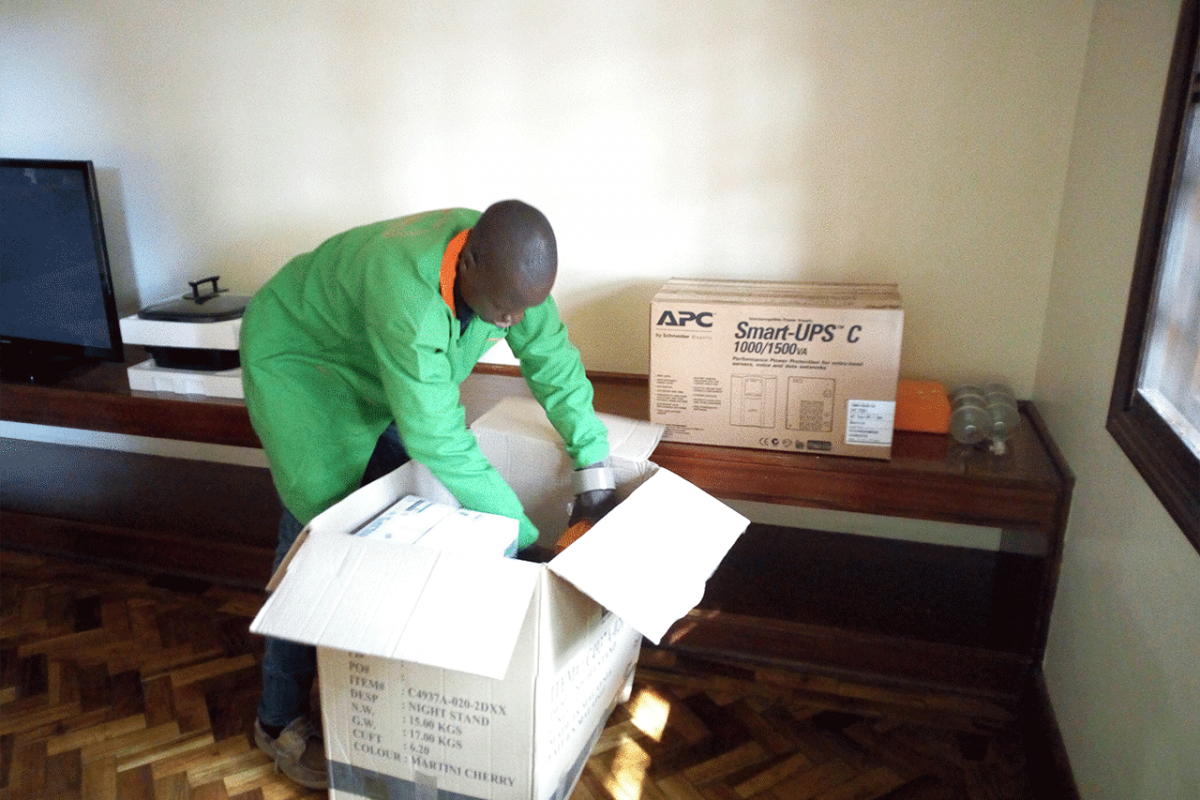 a mover packing electronics in a box